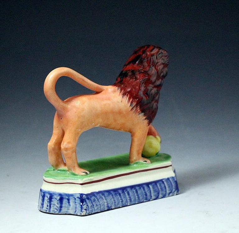 English Staffordshire Pottery Figure of a Lion with a Pearlware Glaze Early 19th Century For Sale