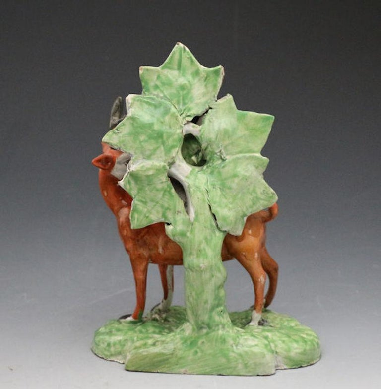 An exceptionally rare pottery pearlware figure of a stag with colorful bocage. The bocage type is probably unique to this figure and is one of the rarest forms. Retains the label of dealer Jonathan Horne London.  Dimensions: 6.00 inch wide 8.00