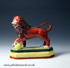 Staffordshire pottery pearlware figure ofa standing lion on base early 19th C