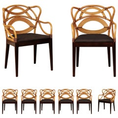 Staggering Set of 8 Sculptural Scalloped Back Rattan Dining Chairs, circa 1995