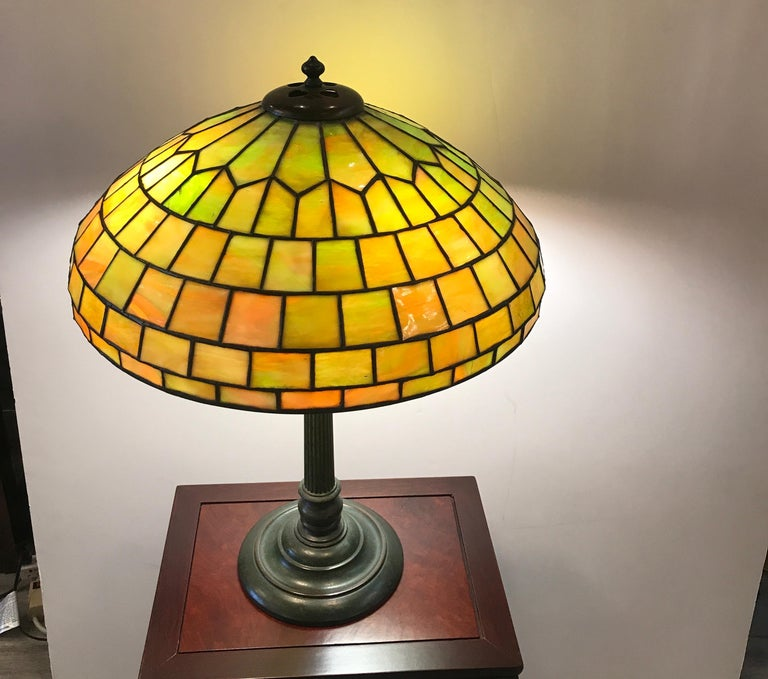 A leaded glass and bronze table or desk lamp, early 20th century Duffner & Kimberly was a New York City company which produced leaded glass and bronze lamps around the same time as Louis Comfort Tiffany, Tiffany Studios. The Duffner & Kimberly