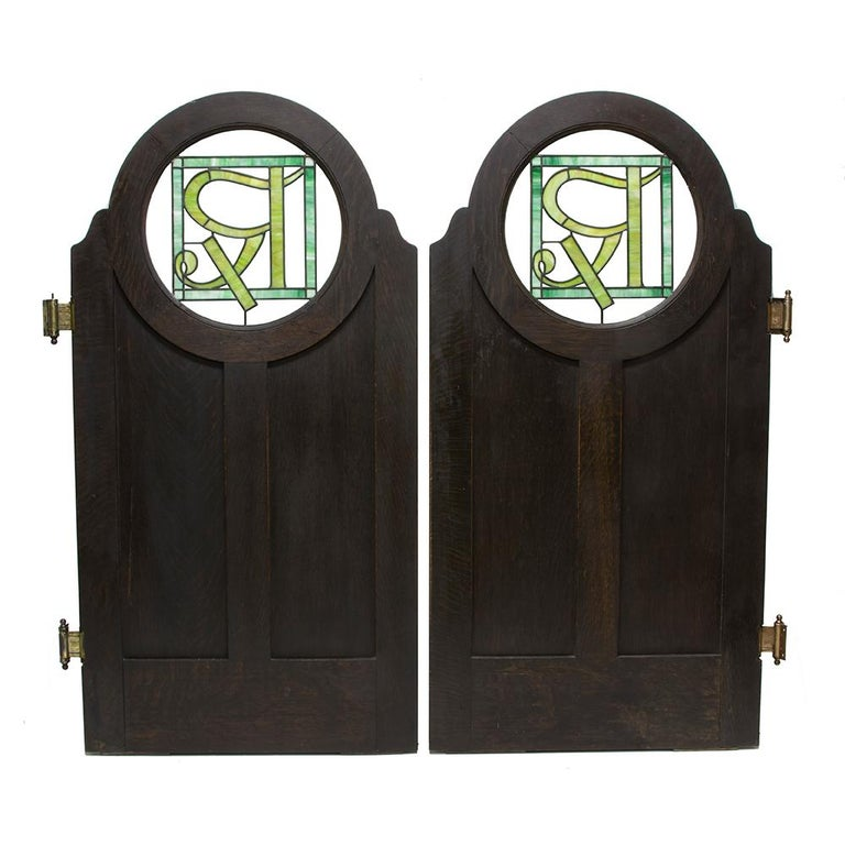 These phenomenal doors have a history in upstate New York. They were once an architectural element in a pharmacy in the town of Chateaugay, NY. The craftsmanship is very clear in the thick quarter sawn oak, which has been treated with a dark stain.