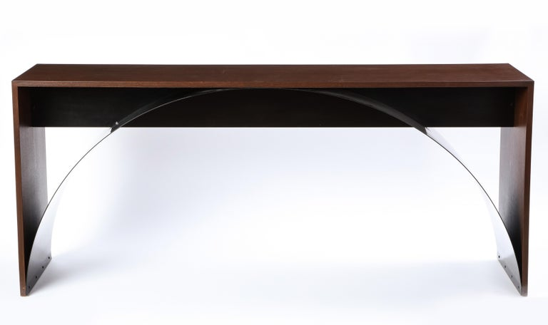 This modern console table is composed of a stained oak frame with a black painted metal sheet spanning in an arch from foot to foot. The formal simplicity and the crispness of the lines highlights the subtle and nuanced workmanship of the piece -