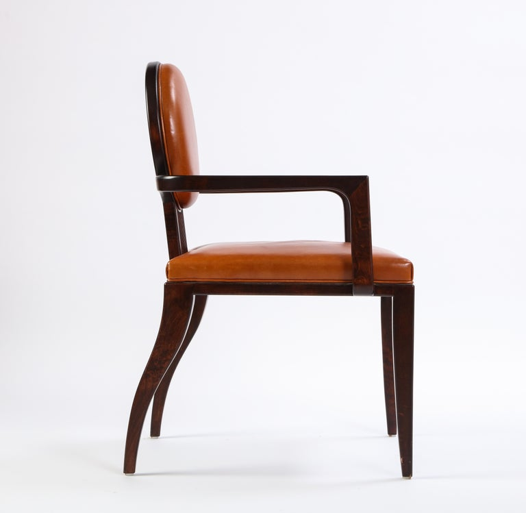 Designed by famed Juan Montoya, this modern armchair has beautifully stained wood and comfortable leather upholstery. Structurally sound and ready to place, this reads as a simple, yet striking, undeniably art deco accent piece. Collectors and