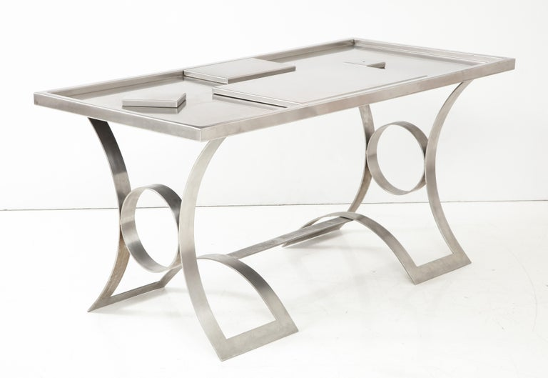 Manufactured in the 1970s, stainless steel desk with unusual details and placements.