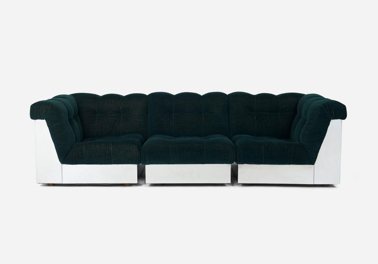 Stainless steel cased sectional sofas with original, deep tufted mohair velvet upholstery, designed by Giorgio Montani for Souplina. Manufactured by Souplina. French 1970s. 4 corner sections are 33