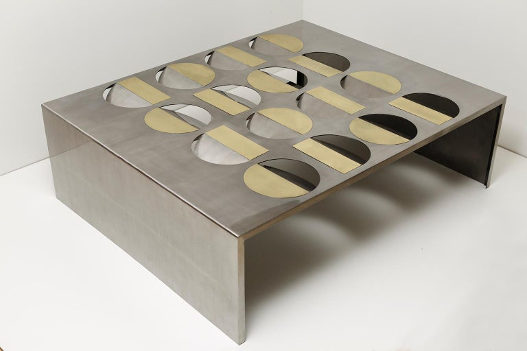 Stainless steel moonland coffee table by Ana Volante Studio The Moon Collection Dimensions: L 150 x W 120 x H 45 cm Materials: Stainless steel, brass, glass on top  Ana Volante, founder of Ana Volante Studio, is a Venezuelan designer