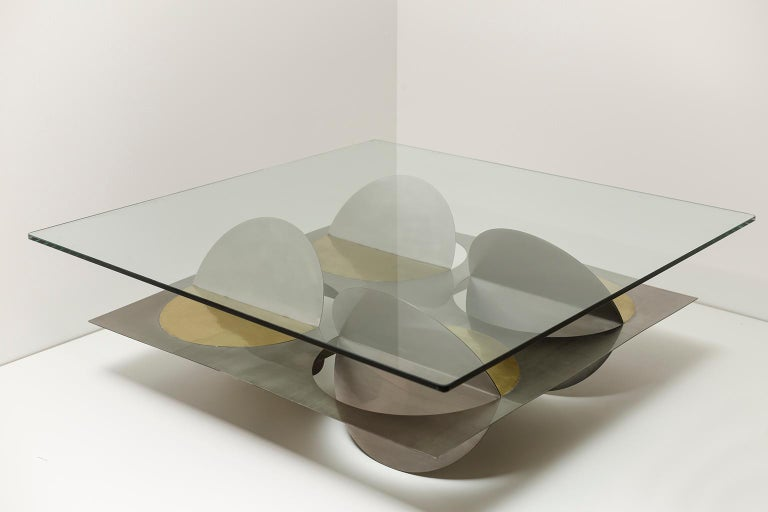Stainless steel Moonsky coffee table by Ana Volante Studio The Moon Collection Dimensions: L 120 x W 120 x H 45 cm Materials: Stainless steel, brass, glass on top  Ana Volante, founder of Ana Volante Studio, is a Venezuelan designer specialized