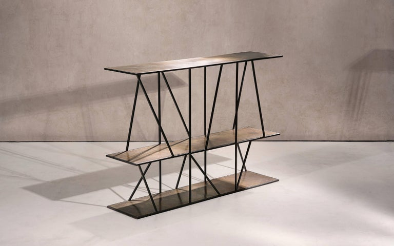 A sculptural console table in black patinated steel and patinated brass. Handcrafted in the North to order.  1250L x 300W x 850H  Custom sizes and finishes are available.  Made to order in 12 weeks. Price excludes VAT.