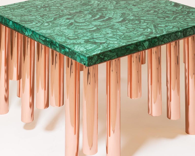 Stalactite model coffee table, 32 polished copper legs, rectangular Malachite table top designed and produced by Studio Superego.  Biography Superego editions was born in 2006, performing a constant activity of research in decorative arts by