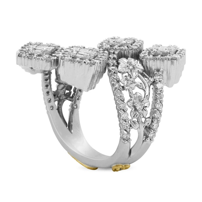 Stambolian 18 Karat White Gold Baguette Round Diamond Floral Bypass Flower Ring  This work of art is hand made in the United States by Stambolian and features a floral pattern on both sides of the band leading to the baguette diamonds center. The