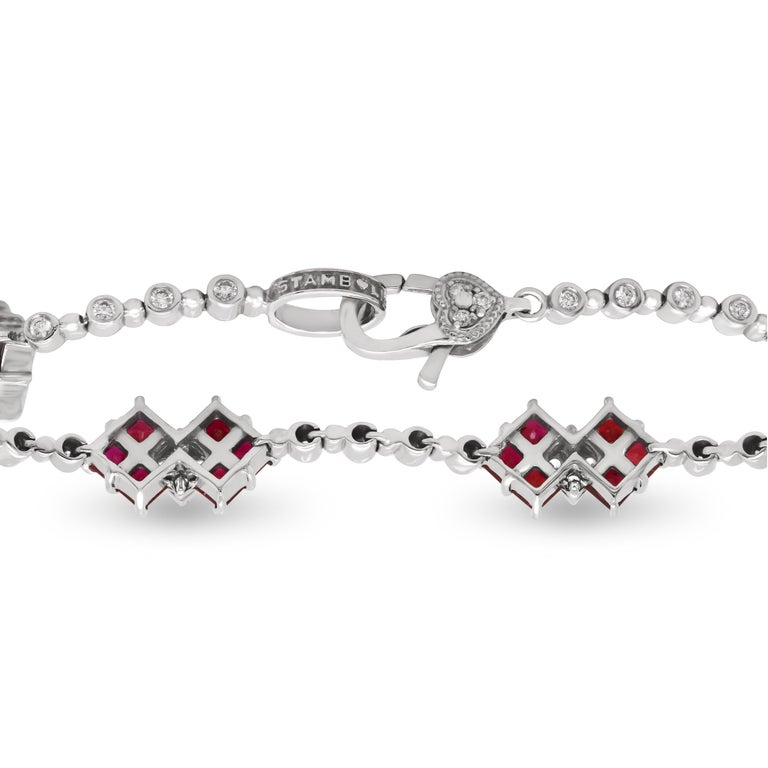 Stambolian 18K White Gold Diamond Princess Cut Ruby Tennis Bracelet  This state of the art bracelet by Stambolian is created in solid 18k white gold with diamonds and rubies. This bracelet is also available in blue sapphire and tsavorite.  Apprx. 5