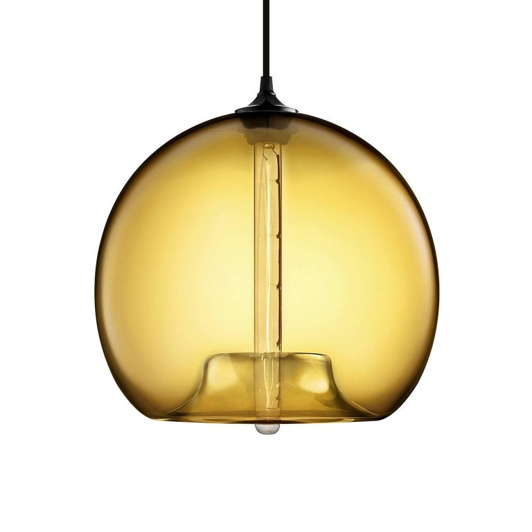 The first design that inspired Niche, the Stamen pendant boasts a voluptuous body that tucks into itself unexpectedly. Every single glass pendant light that comes from Niche is handblown by real human beings in a state-of-the-art studio located in