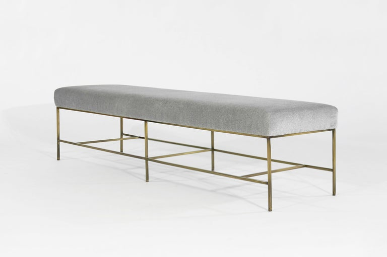 The Architectural Bench is light and angular with impeccable lines. The extra-long cushion upholstered in Royal Alpaca is uplifted with an antiqued brass frame. Paul McCobb's design influence shines through with masterful minimalism and dynamic
