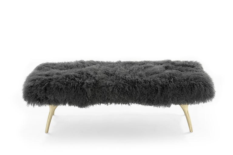 The Crescent Bench floats effortlessly, poised on brass fingertips. Inspired by 20th century visionaries like Vladimir Kagan and Gio Ponti, this bench offers a unique perspective. The plush bench cushion is fully wrapped charcoal Mongolian wool