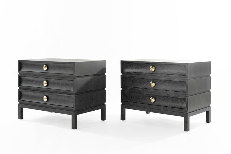 We pay homage to one of the Mid-Century Modern era's greats, Paul T. Frankl This particular set has been done in white oak with a silver cerused finish. Three drawers provide ample storage space. Solid dome-shaped brass pulls add the perfect touch