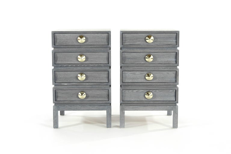 We pay homage to one of the Mid-Century Modern era's greats, Paul T. Frankl  This particular set has been done in white oak with a grey limed finish. The four drawers provide ample storage space. Solid dome-shaped brass pulls add the perfect