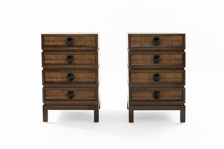 We pay homage to one of the Mid-Century Modern Era greats, Paul T. Frankl  This particular set has been done in walnut, featuring burl drawer fronts.  The four drawers provide ample storage space. Solid dome-shaped bronze pulls add the perfect