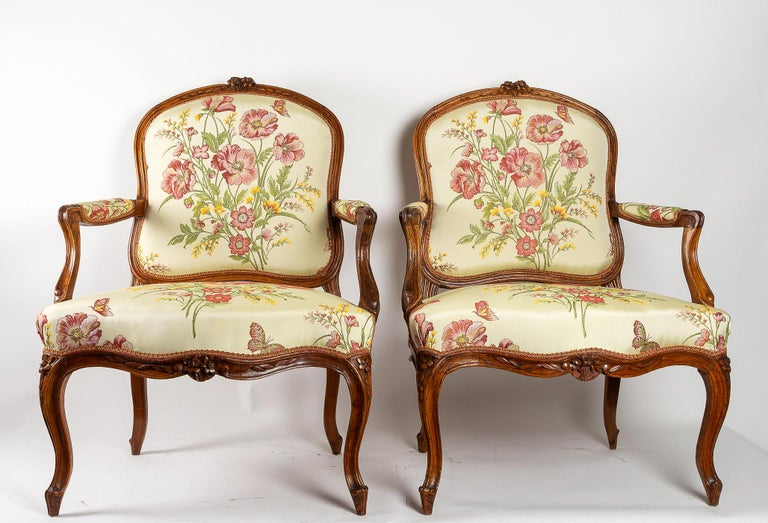 Stamped by Martin Jardin pair of large Louis XV walnut armchairs, circa 1760.  Elegant and decorative pair of large walnut carved armchairs, stamped by Martin Jardin.  French work, manufactured in the city of Lyon, late Louis XV period, circa
