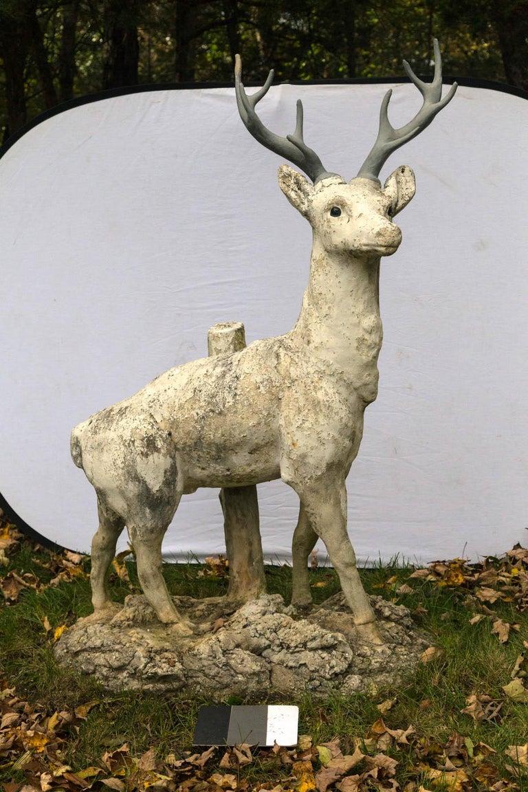Standing cement deer with zinc antlers.