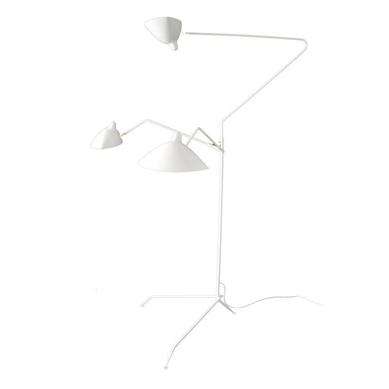 This is the most versatile lamp of the Mouille collection. Each 'chapeau' shade can be oriented differently. Sculptural in form with three rotating arms, it stands majestically on a tripod base ending with tapered legs.   Accent pieces are in