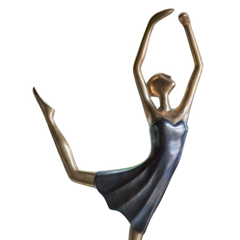 Sculpture star dancer all in casted brass. On casted brass base. With blue dress.