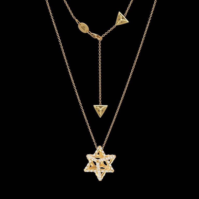 Merkaba 18k yellow gold necklace featuring a total of approximately 1.12 carats of round brilliant diamonds, F-G color and VVS2-VS1 clarity. This heirloom-quality, sacred geometric jewelry piece, suspends elegantly at the chest, measuring 0.68
