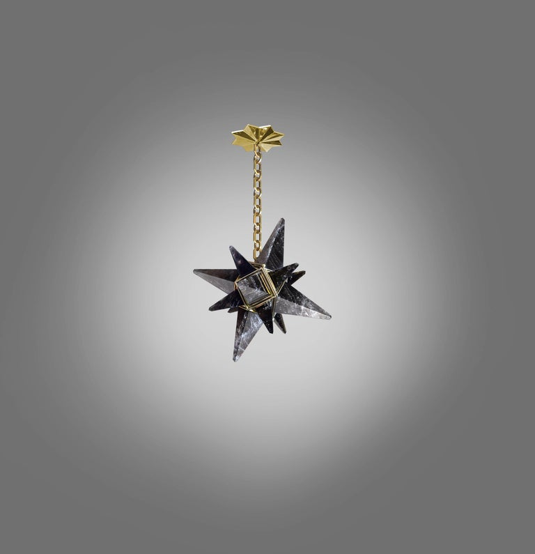 Deco style star forms smoky rock crystal chandelier with polish brass frame. Created by Phoenix Gallery, NYC. One socket installed. Use one 75 watts LED candelabra light. Light bulb supplied. The chandelier is 18