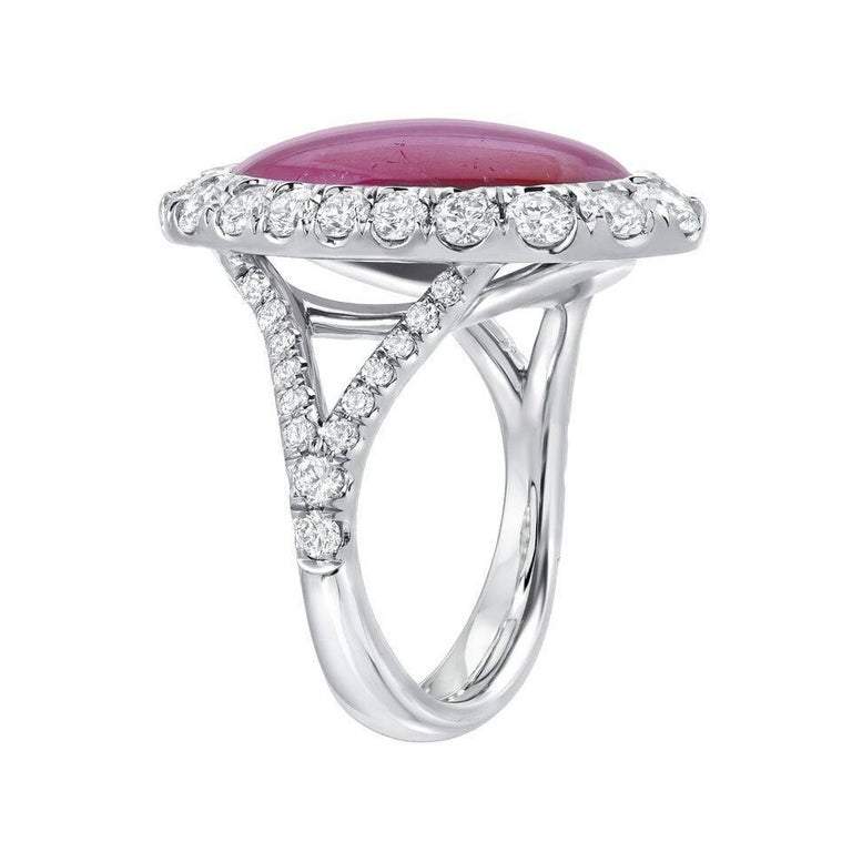 Phenomenal 9.91ct unheated Star Ruby, displaying distinct and impeccably defined Asterism, surrounded by 48 gradually set, round brilliant diamonds, weighing a total of 1.71ct, in this magnificent, hand crafted platinum ring. The total length of the