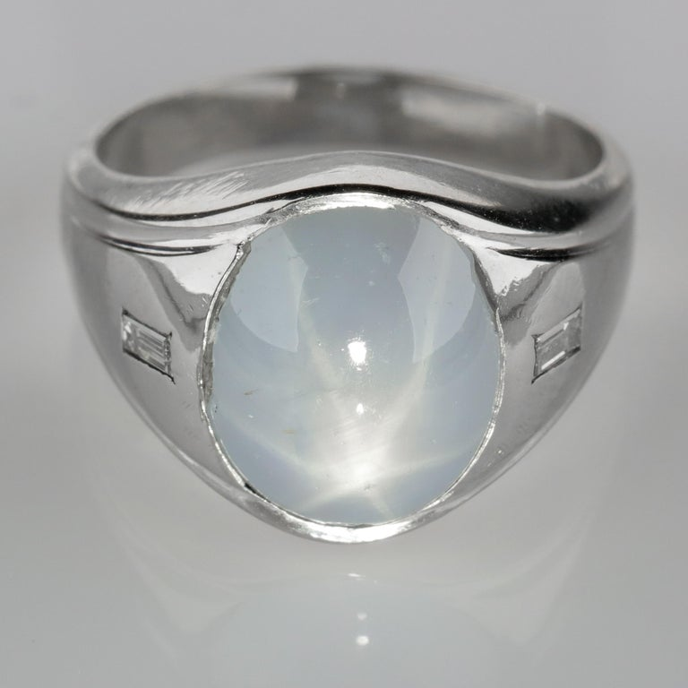 This sleek and tailored Mid-Century ring features a translucent, 13-carat pale blue natural and untreated Ceylon star sapphire with a bright and well-defined (though difficult to photograph), six-pointed star. Unlike the vast majority of star