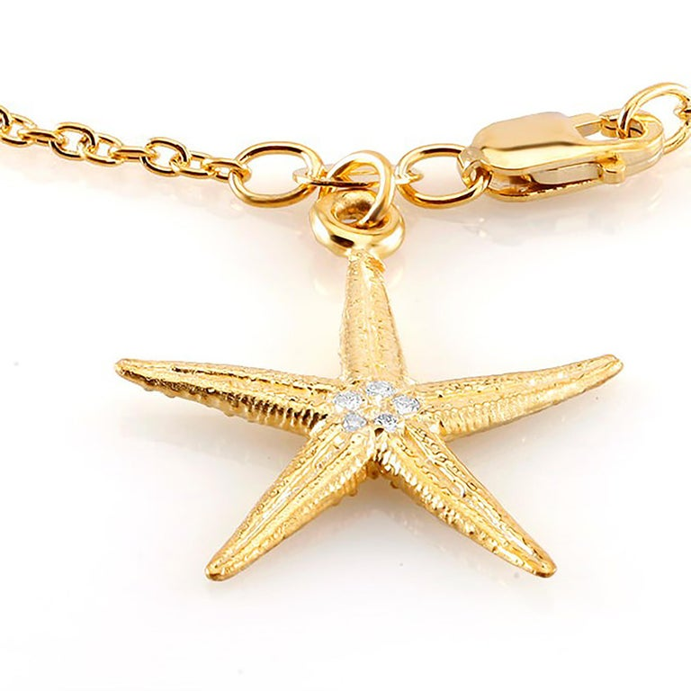 Sterling Silver link bracelet  Star shape diamond charm measuring one inch Lobster claw clasp Four diamond weighing 0.10 carat  Bracelet seven inch long  New bracelet Yellow gold plated