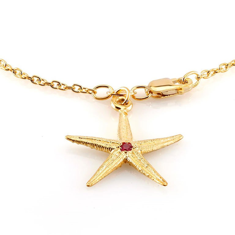 Sterling Silver link bracelet  Star shape charm measuring one inch Lobster claw clasp One ruby weight 0.10 carat  Bracelet seven inch long  New bracelet Yellow gold plated