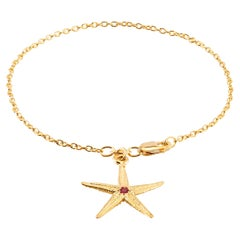 Star Shape Pave set Ruby Yellow Gold Plated Silver Charm Bracelet