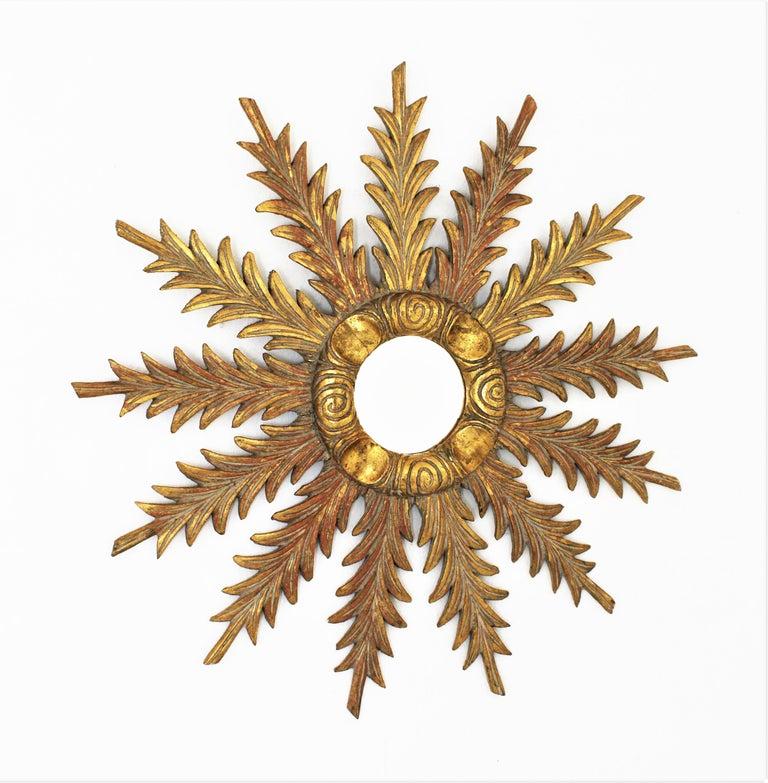 Starburst Sunburst Carved Giltwood Mirror, Spain, 1930s In Excellent Condition For Sale In Barcelona, ES