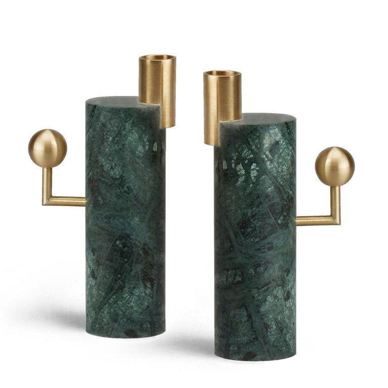 A beautiful union of brass and marble, the 'Stargazer' candleholders are inspired by orreries - mechanical models of the solar system used since classical times. Available in two designs, these candlesticks have a powerful sculptural presence far