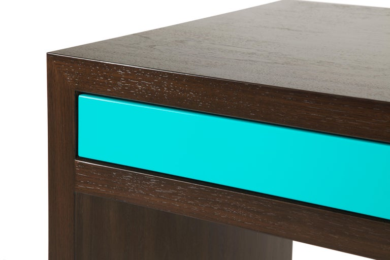 A Minimalist's dream, the stash desk is a perfect combination of deep, rich walnut with a pop of color. Its slim and clean profile is ideal for small spaces. The three drawers feature push-release hardware and sleek lacquer fronts. The 3-inch high