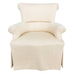 Stately and Elegant Club Chair in a Pale Apricot Weave with Contrast Skirting