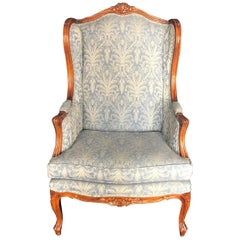 Stately Louis XV Style Carved Wingback Armchair