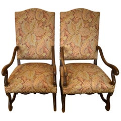 Stately Pair of High Back Antique Walnut and Upholstered Armchairs