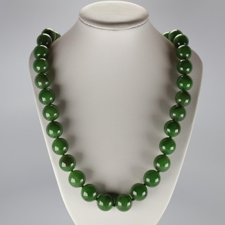 This statement necklace of enormous jade beads with an 18K yellow gold diamond-studded ball clasp is almost beyond description, but I will try.  As a certified professional gemologist and a second-generation jade collector who has had the privilege