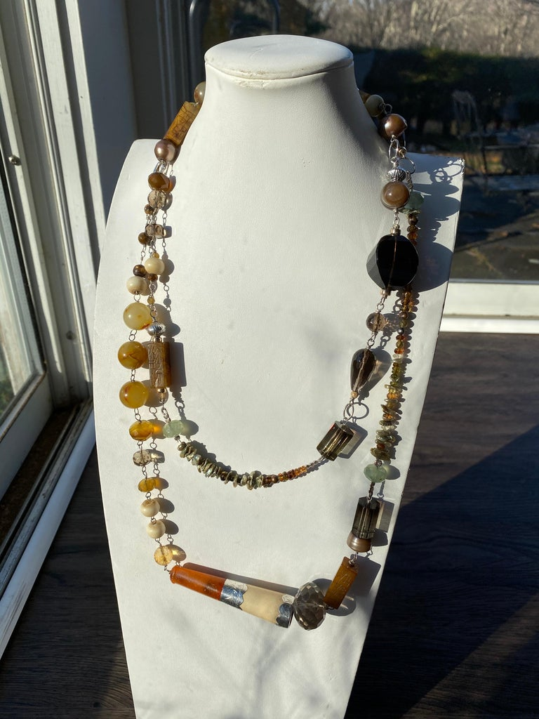 From the Jane Magon Collections, Australian Landscape comes this one of a kind dramatic long necklace with an impressive array of gemstones. Citrines, monkey Quartz, Jades, Jaspers, Chalcedony, Dyed Keshi Pearls, Brown Freshwater Pearls, Carved tiny