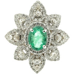 Statement Ring Featuring White Diamond and Emeralds in White Gold