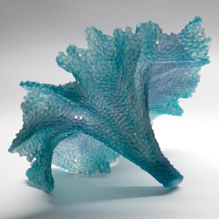 Static Movement is a unique textured teal and grey glass sculpture by the Danish artist Monette Larsen. Each of Larsen's highly detailed sculptures are first modelled in wax, where she painstakingly carves all the fine surface detail which is later