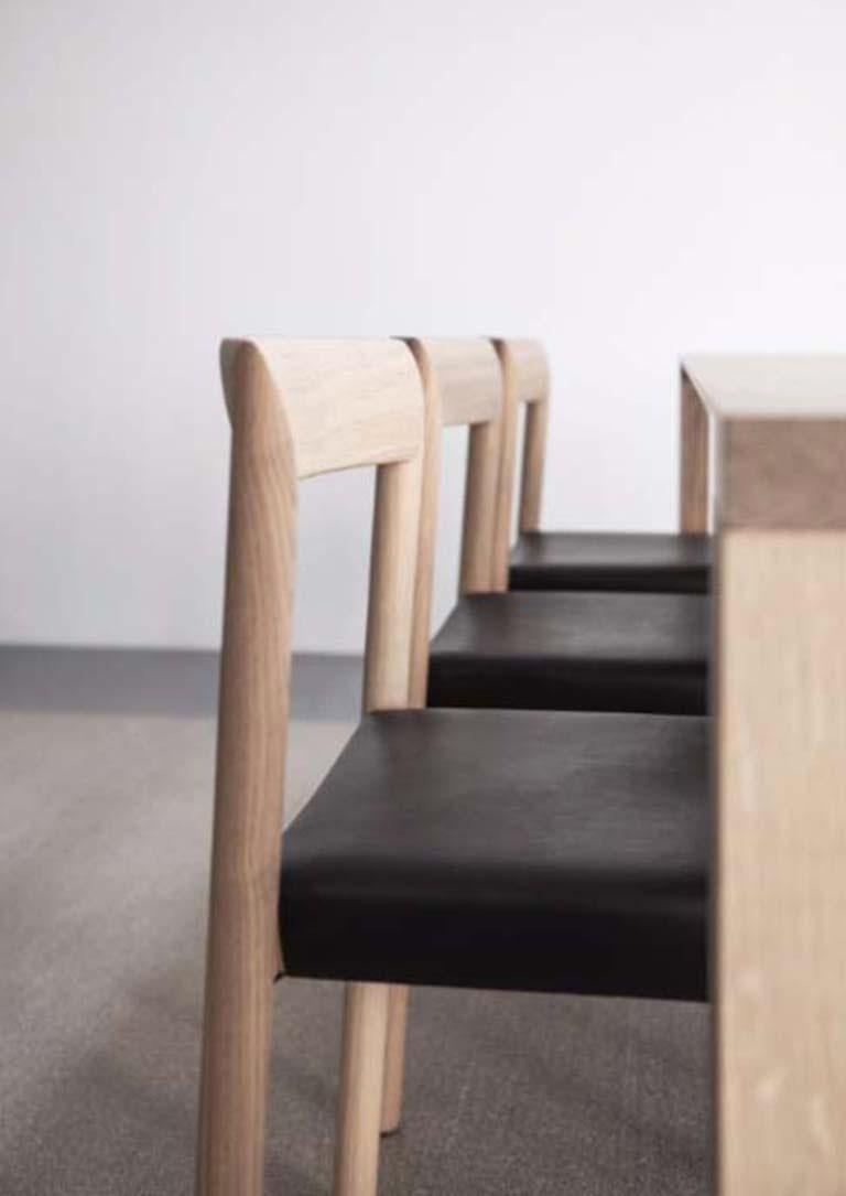 Using traditional woodworking techniques and cutting edge technology, the Stax chair is a beautiful piece of solid wood furniture. The mitered corners create the illusion of a continuous wood grain.  Additional information: - Dimensions: D. 50 x