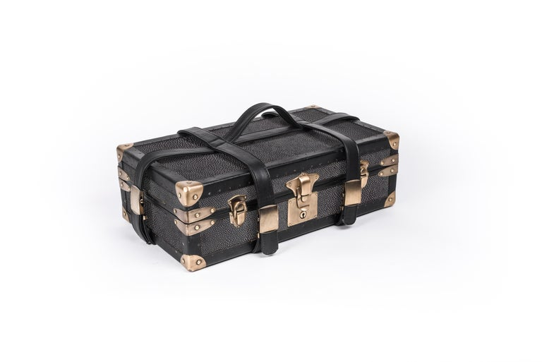 As an ode to vintage steamer trunks, R&Y Augousti revisits this old-world piece in a modern context by recreating their own version inlaid in their signature material shagreen. This steamer inspired-trunk is perfect for traveling or using as a