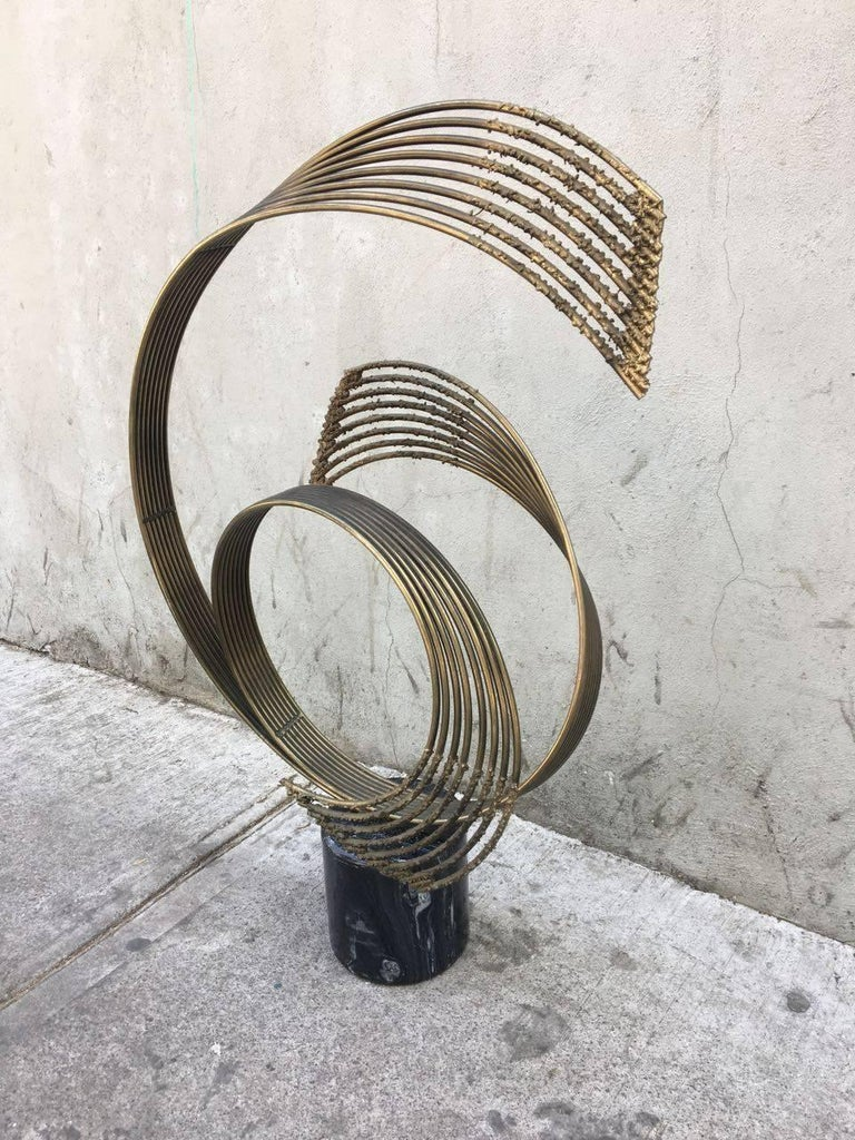Abstract sculpture by Curtis Jere, made in steel and brass, with marble base.