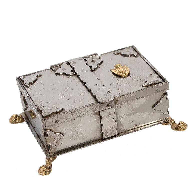 This exceptional and unique stainless steel box from Italy with brass details including lion paw feet is lined in original brown fabric.