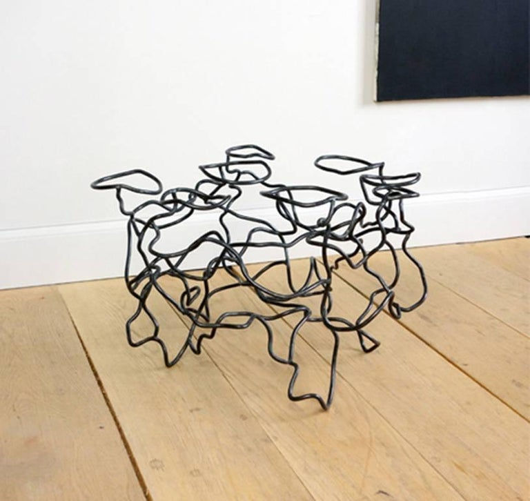 """New York artist Rebecca Welz's sculptural """"Scribble Table"""" side table is made of steel rods that are bent, twisted, and welded into an artful tangle or """"scribble."""" Welz has described her welded steel sculptures as """"large, kinetic drawings in space,"""""""