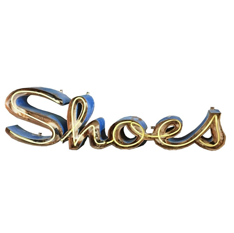 The ultimate statement for any dressing room! This great sign originally hung outside a shoe store, and has been brought back to life by us. The neon has been re-made, and a new transformer and plug added. The sign retains its' original old