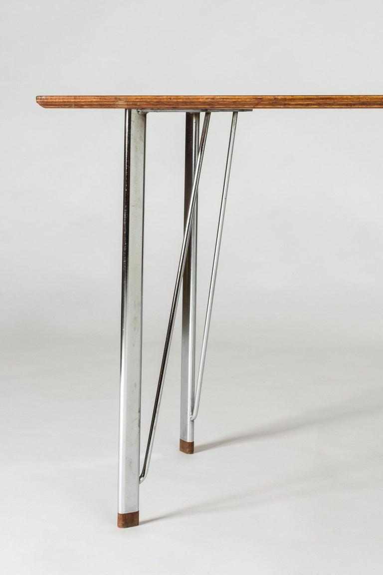 Scandinavian Modern Steel and Teak Desk by Arne Jacobsen for Fritz Hansen. Denmark, 1960s For Sale